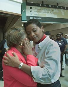 Marlene Coleman (R) who works for the Department of Aviation comforts Jacqueline Berry (L) who works at concessions at Hartsfield International Airport in Atlanta, Georgia comfort each other after a moment of silence on September 14, 2001. The day has been declared a